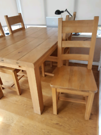 Solid heavy oak ladder back dining chairs