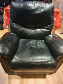 Black faux leather armchair. Clean and in good condition.