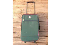 Small green carry on trolley suit case.
