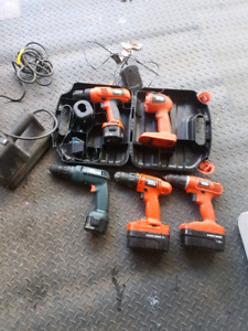 Black and Decker drills, light and wall paper remover.