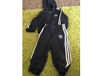 2 adidas tracksuits 6/9 months