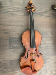 Selling an excellent condition of 100 years old violin and bow