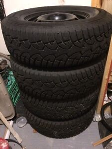 265/70/17 general altimax artic on rims
