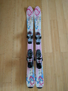 Pair of kids skiis and boots