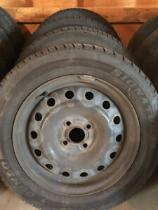 4 Winter Tires on Steel Rims Good Condition
