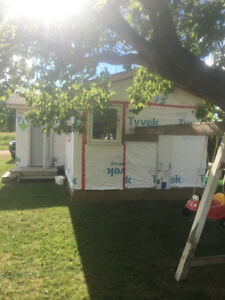 380 sq ft insulated and wired guest house/workspace.