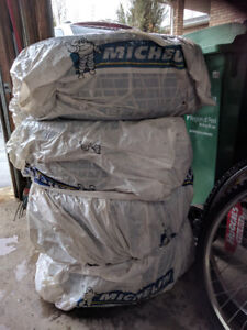 Four all season Michelin tires with Rims 215/55 R16     175$ OBO
