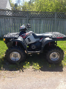 2 Polaris Sportsman 700s and Parts