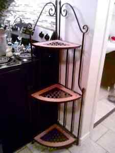 Wrought iron and terra cotta planter stand