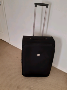 Tripp brand large modern soft suitcase for sale.