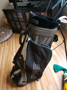 Ping golf bag with some clubs