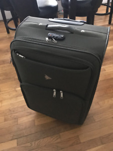 """Grey 31"""" x 12"""" x 18"""" luggage - 360 spin wheels (PENDING PICK-UP)"""