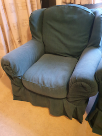Armchair with removable covers and loose cushioned back