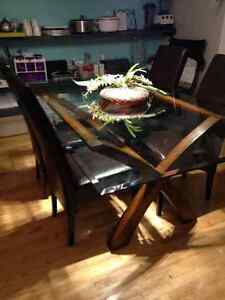 Large Glass Dining room table with wooden base