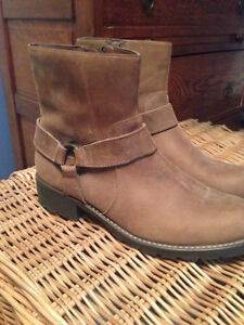 Women's Clarks tan suede ankle boots.