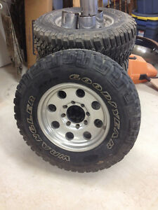 "4 EAGLE ALLOY ALLUM 17"" RIMS AND 4 GOODYEAR WRANGLER TIRES"