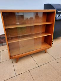 Teak display unit with sliding glass doors