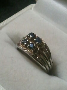 very nice 14k white gold with 4 saphires