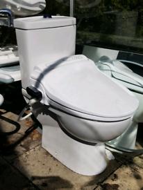 Adult Bio bidet electric toilet seat and floor standing toilet.
