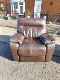 16. 1 seater brown leather reclining armchair