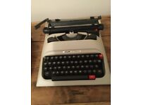 Vintage Olivetti letter a 12 portable typewriter in hard case,