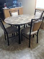 Kitchen table w/four chairs and extention leaf