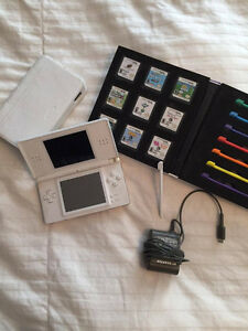 White Nintendo DS Lite + 10 games + travel case + 7 styluses
