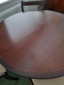 Round dark brown table and 4 chairs
