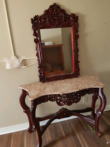 Beautiful antique hand carved oak table and matching mirror.