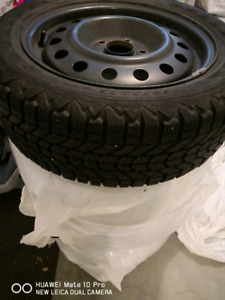 Winter tires on rim for sale