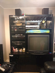 Wall Unit with multiple audio system gadgets for $500