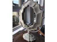 Free standing ceramic mirror.