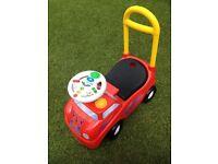 Ride along musical car with push along handle
