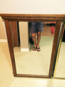 Solid Oak framed bevelled mirror in mint condition