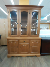 Wooden display unit with glass doors