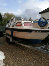Weston 670 boat, 15hp outboard and trailer
