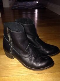 Black leather topshop boots.