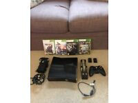 Xbox 360 Black console bundle with games.