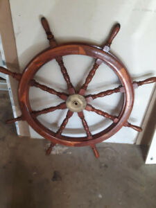 ships wheel with some history behind it