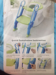 Potty trainer with ladder.   New in package still.