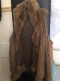 Sleeveless fur cape