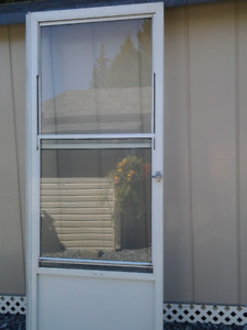 White storm door with glass and screen