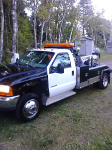 4X4  Tow Truck with 10' snow dog snowplow.
