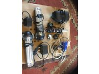 A selection of aquarium equipment. Pump, lights, etc.