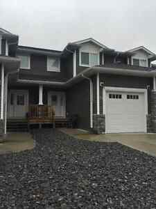Townhouse with 2 master suites & finished basement.