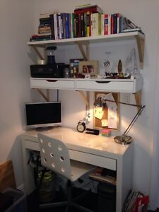 White wooden desk with books lot and drawers
