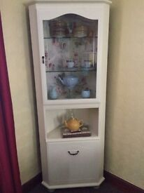 Mahogany corner unit. Painted cream with rose style wallpaper inside