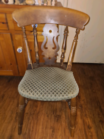 12 Solid pub chairs and 4 solid ladder back chairs