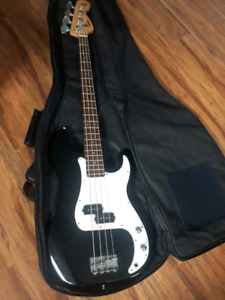 Fender bass guitar, amp, and case