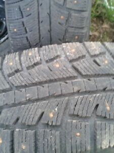 """A set of 4-225/70/16"""" Studded tires /Rims,LOTS of tread"""